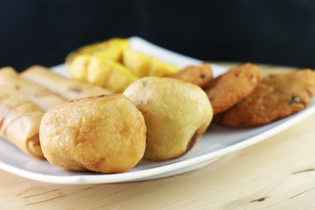 Assorted Malay traditional food - Kuih Cara Berlauk, Cucur Badak, Popiah, Vadeh - Focus on Cucur Badak