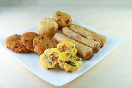 flavoursome: Assorted Malay traditional food on a white plate - Kuih Cara Berlauk, Cucur Badak, Popiah, Vadeh