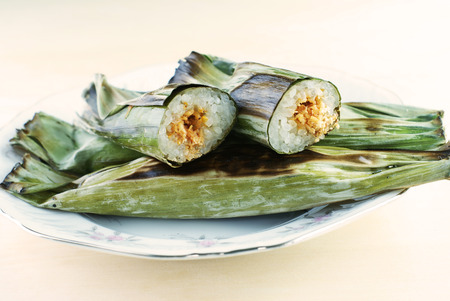 Malay traditional food - Pulut Panggang, Grilled Glutinous Rice photo