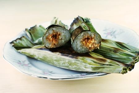Malay traditional food - Pulut Panggang, Grilled Glutinous Rice Stock Photo