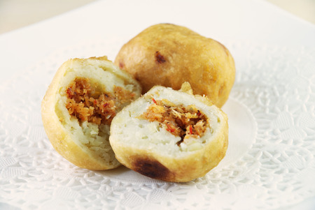 Malay traditional food - Cucur Badak, sweet potato with coconut filling ball photo