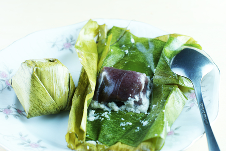 Malay traditional food - Kuih Koci or Kochi or Passover Cake with a spoon