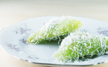 screwpine: Malay traditional food - Kuih Lopes, pandan flavoured glutinous rice eaten with palm sugar syrup