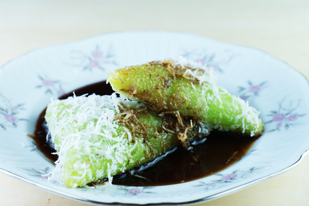 Malay traditional food - Kuih Lopes, pandan flavoured glutinous rice with palm sugar syrup
