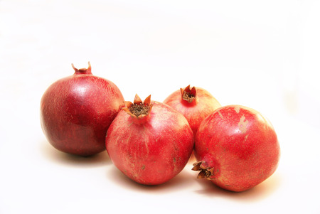 Group of four ripe Pomegranate Fruit or Buah Delima Stock Photo