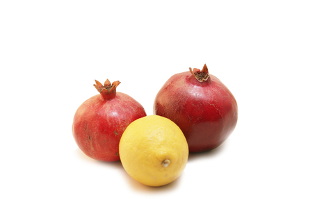 Two Pomegranate Fruit or Buah Delima with a Lemon