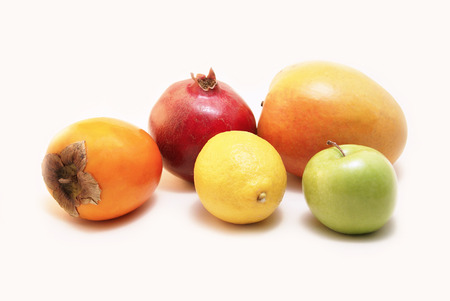Five pieces of colourful fruits - Lemon, Granny Smith Green Apple, Pomegranate, Hachiya Persimmon, Mango photo