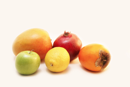 Five pieces of colourful fruits - Lemon, Granny Smith Green Apple, Pomegranate, Hachiya Persimmon, Mango