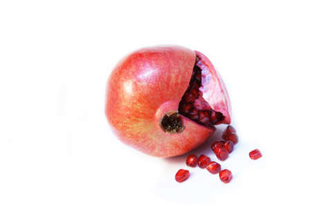 Fresh cut opened Pomegranate fruit or Buah Delima with seeds fallen