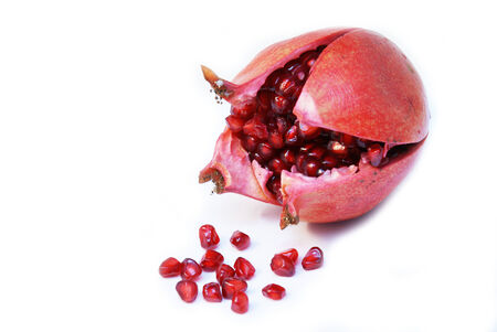 Cut open ripe Pomegranate fruit or Buah Delima photo