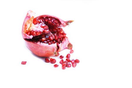 Cut open ripe Pomegranate fruit or Buah Delima