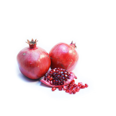 punica granatum: Cut open ripe Pomegranate fruit or Buah Delima