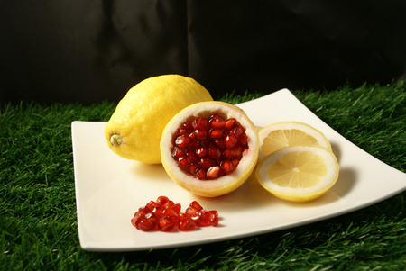 Loose pieces of Pomegranate fruit or Buah Delima in Lemon with Lemon slices