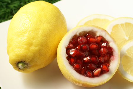 flesh colour: Loose pieces of Pomegranate fruit or Buah Delima in Lemon with Lemon slices