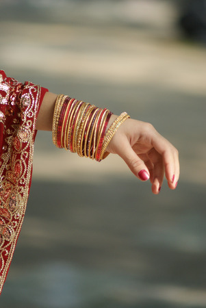 Young Indian girl showing bangles on her hand