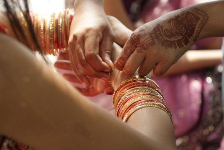 Young Indian girl wearing bangles photo
