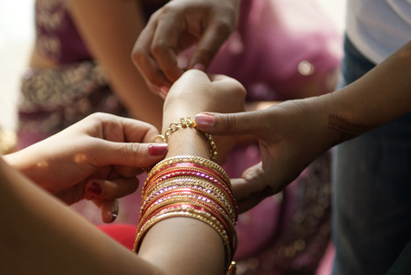 Young Indian girl wearing bangles Stock Photo