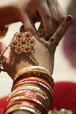 Young Indian girl wearing bangles and hand ring piece decoration photo
