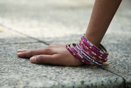 Indian girl hand with purple bangles Stock Photo