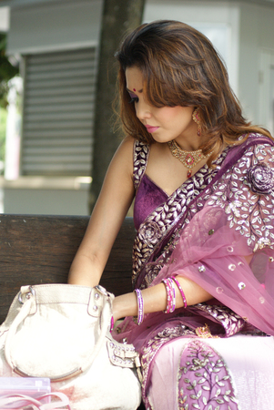 Young Indian girl in purple traditional saree clothing photo