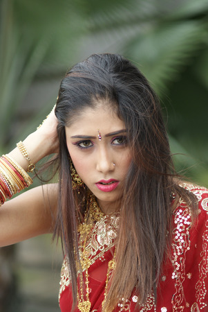 Young Indian girl in red traditional saree clothing photo
