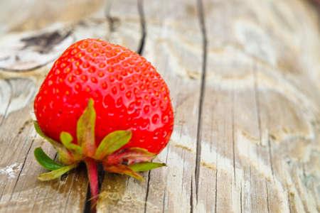 ot: Isolated strawberry ot the wood background Stock Photo