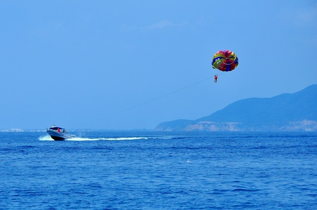 parasailing: Parasailing in Nha Trang city, Vietnam  Stock Photo