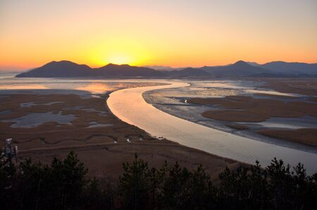 Letter S shaped river in sunset  Suncheon bay in Suncheon city, South Korea famous with its fabulous sunset and the letter S shaped river photo