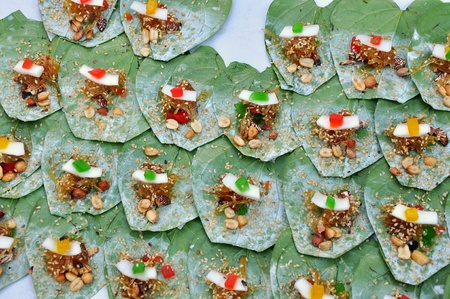 spat: Making betels on the street  Areca nut and spices wrapped in a betel leaf which is chewed and then spat out  Stock Photo