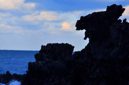 dragon head: Dragon Head Rock, Jeju, Korea  Yongduam Rock  Dragon Head Rock  was created by strong winds and waves over thousands of years  It s located in Jeju island, South Korea