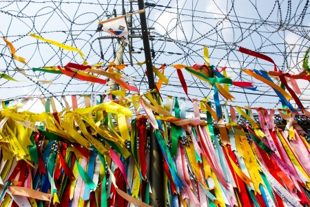 north korea: Millions of prayer ribbons tied to the fence wishing peace and unification for North and South Korea  Taken in Demilitarised Zone  DMZ  in South Korea