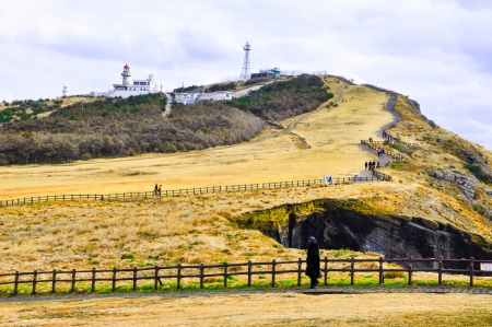 south island: Rocky cliffs in Udo island, Korea  Udo is a small and famous tourist island near Jeju island, South Korea
