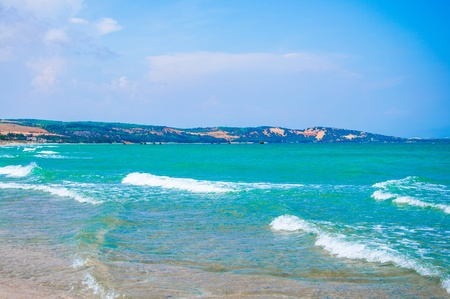 Pure sea in Mui ne bay, Vietnam  Mui ne is a famous bay with beautiful beaches in Vietnam photo
