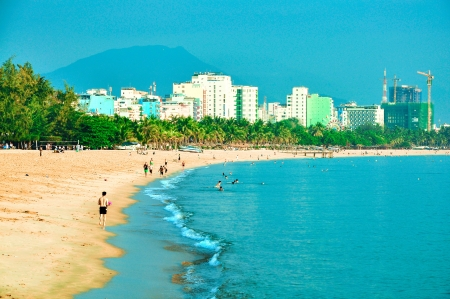 trang:  Nha Trang beach in the morning  Nha Trang is a coastal city in Vietnam, famous with beautiful beaches and bays Editorial