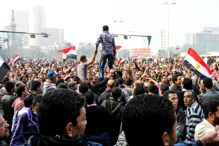 protesters: CAIRO, NOV 22, 2011-Thousands of Islamist protesters flocked to Cairo s Tahrir Square, Egypt  People were reported dead and injured because of tear gas, rubber bullets of riot police