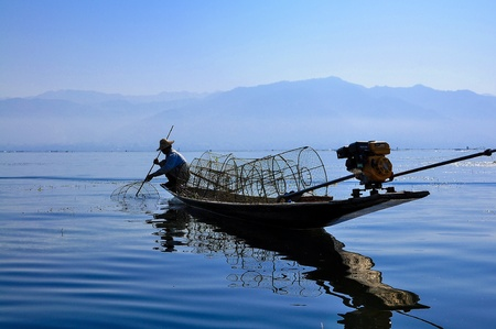 inle: Fishermen in Inle lakes sunset, Myanmar  Burma  Stock Photo