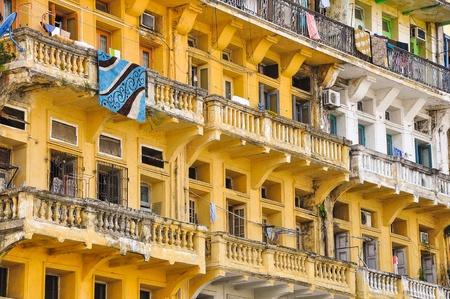 tenement: A crowded tenement apartment building in Yangon, Myanmar  Yangon is the former capital of Myanmar or Burma  Editorial