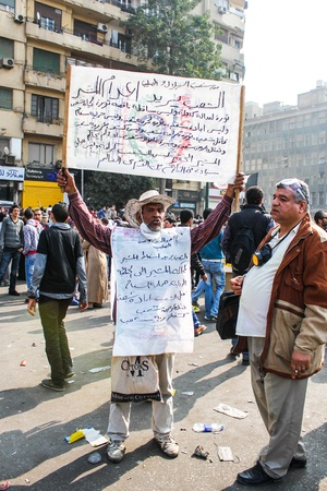 reported: CAIRO, NOV 22, 2011-Thousands of Islamist protesters flocked to Cairo s Tahrir Square, Egypt  People were reported dead and injured because of tear gas, rubber bullets of riot police