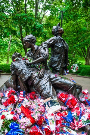 WASHINGTON, D C  - MAY 27, 2013  People visit and lay flowers at the Vietnam Veterans Memorial on May 27, 2013, in Washington, D C