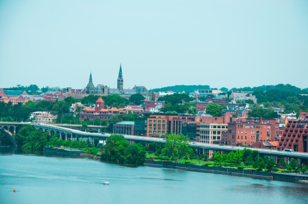 washington landscape: Washington DC by the Potomac river  elevated view of Washington DC by the Potomac river  In the picture are Key bridge, and Georgetown waterfront park and harbor