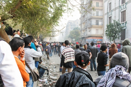 CAIRO, EGYPT - NOV 22-Thousands of protesters flocked to Cairo s Tahrir Square, Egypt, Nov 22, 2011  People were dead and injured because of tear gas, rubber bullets of riot police