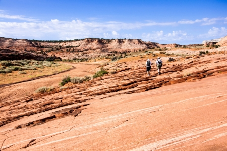 A senior couple is hiking in Grand Staircase - Escalante national monument, Utah, USA  photo