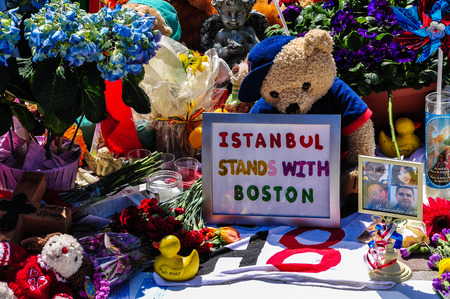 solace: BOSTON CITY - APR 30  Makeshift Memorial for Marathon bombing victims at Copley Square, Boston, Massachusetts on April 30, 2013  Hundreds of people lay flowers, display messages of hope for 4 victims