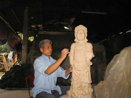 worshiped: HAI DUONG, VIETNAM, July, 18: artist  of Cay pottery village  clay statue of a deity on July, 18,2013 in Hai Duong, Vietnam. The deity was worshiped in the temple in Vietnam