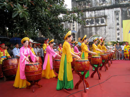 HAI DUONG, VIETNAM, February, 25: Folk artists in traditional costume performing drum at Con Son, Kiep Bac festival on February, 25, 2013 in Hai Duong, Vietnam.