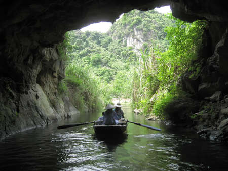 ranked: NINH BINH, VIETNAM, JULY, 20: Unidentified tourists in Trang An  on JULY, 20, 2013. Trang An is the scenic area, ranked special of Vietnam.