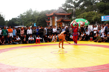 catch wrestling: HAI DUONG, VIETNAM, March 2: wrestlers compete in national wrestling on March 2, 2013 in Kiep Bac Con Son festival, Hai Duong, Vietnam. wrestlers touch the ground or be lifted off the ground will be lose