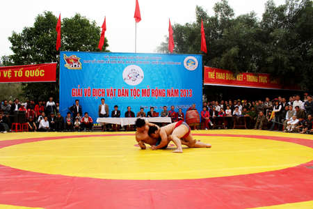 catch wrestling: HAI DUONG, VIETNAM, February 25: wrestlers compete in national wrestling on February 25, 2013 in Kiep Bac Con Son festival, Hai Duong, Vietnam. wrestlers touch the ground or be lifted off the ground will be lose