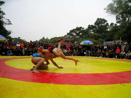 catch wrestling: HAI DUONG, VIETNAM, March 2: wrestlers compete in national wrestling on March 2, 2013 in Kiep Bac – Con Son festival, Hai Duong, Vietnam. wrestlers touch the ground or be lifted off the ground will be lose  Editorial