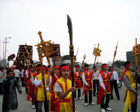 palanquin: HAI DUONG, VIETNAM, March, 4: Group of people in traditional costume palanquin procession holy at at Cao temple festival on March, 4, 2013 in Hai Duong, Vietnam. palanquin procession of holy is the sacred ceremonie of festival